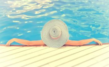 Woman on Vacations with Hat Relaxing -Swimming Pool