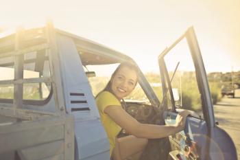 Woman Peeking Inside the Pickup Truck
