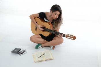 Woman Playing Brown Classical Guitar