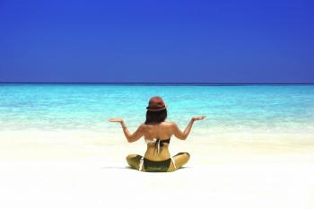 Woman Practicing Yoga on the Beach - Vivid Colors