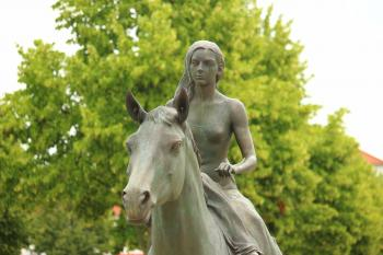 Woman Riding Horse Statue