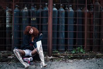 Woman Sitting Beside Tanks