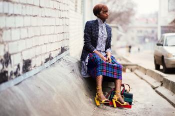Woman Sitting of Concrete Stair Near Gray Car