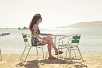 Woman Sitting on Armchair Near Seat