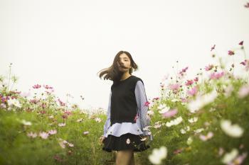 Woman Standing in the Flower Field