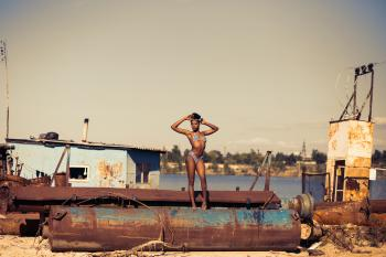 Woman Standing on Brown Steel Container Wearing Two-piece Bikini