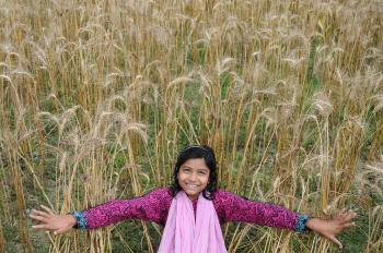 Woman Taking Selfie in Brown Grass Field