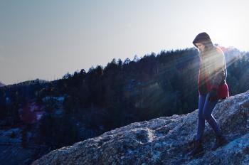 Woman Walking On Mountain