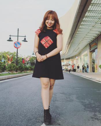 Woman Wearing Black and Red Cap-sleeved Crew-neck Dress and Black High-top Sneakers