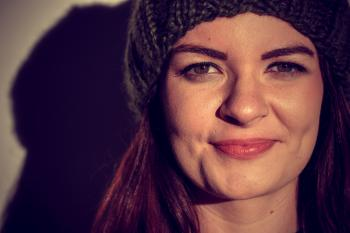 Woman Wearing Black Beanie Smiling for Photo