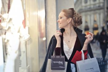 Woman Wearing Black Blazer Holding Shopping Bags