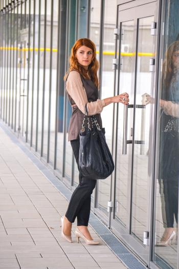 Woman Wearing Black Dress Pants With Black Handbag