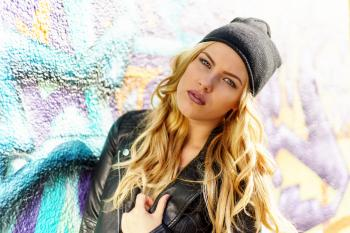 Woman Wearing Black Leather Jacket and Black Knit Cap