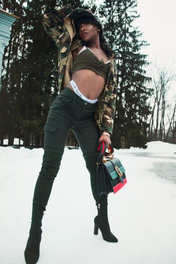 Woman Wearing Black Sports Bra While Holding Handbag