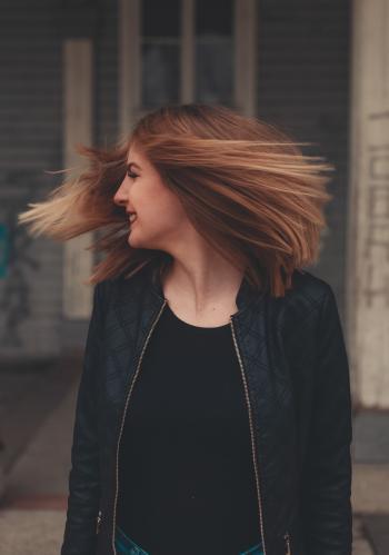 Woman Wearing Black Zip-up Jacket Looking Sideways