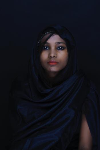 Woman Wearing Blue Hijab