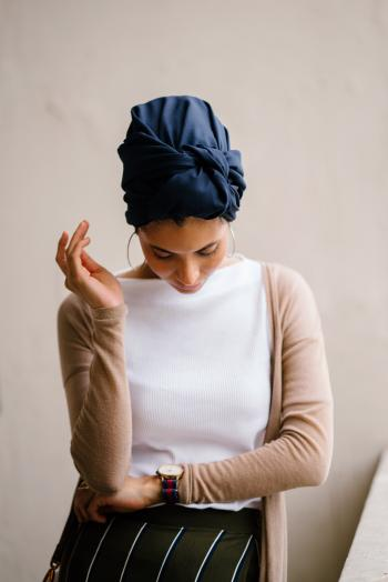 Woman Wearing Blue Turban, White Top and Brown Cardigan