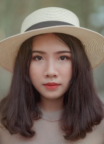 Woman Wearing Brown Bucket Cap