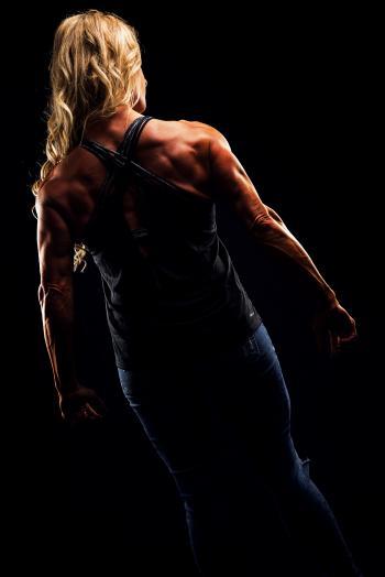 Woman Wearing Criss Cross Back Strap Top Flexing