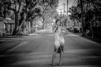 Woman Wearing Dress Standing on Center of Road