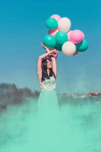 Woman Wearing Green Dress Holding Balloons
