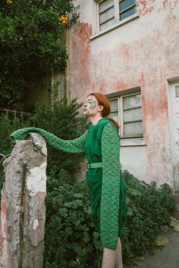 Woman Wearing Green Long-sleeved Costume With Face Paint