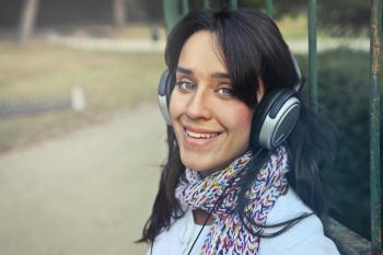 Woman Wearing Headphones With Scarf