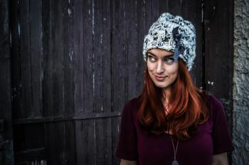 Woman Wearing Maroon Short-sleeved Shirt and White and Grey Knit Cap