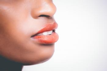 Woman Wearing Orange Lipstick