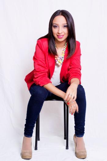 Woman Wearing Red Blazer Sitting on Black Stool