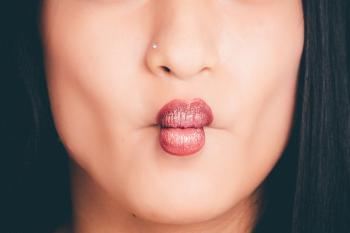 Woman Wearing Red Lipgloss
