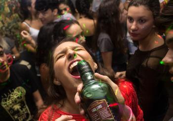 Woman Wearing Red Shirt Drinking