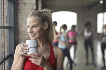 Woman Wearing Red Tank Top Holding White Ceramic Mug
