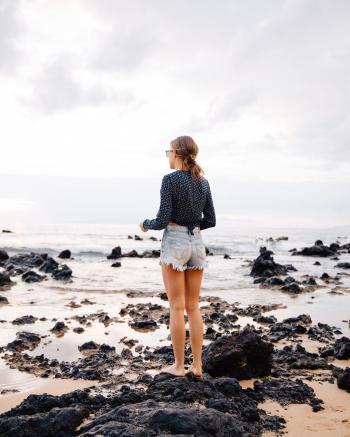 Woman Wearing Washed Blue Denim Shorts
