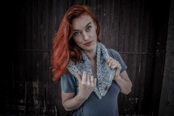 Woman Wearing White and Gray Scarf