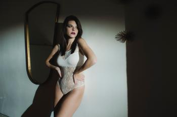 Woman Wearing White Bodysuit