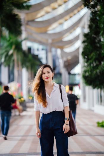 Woman Wearing White Dress Shirt and Blue Pants