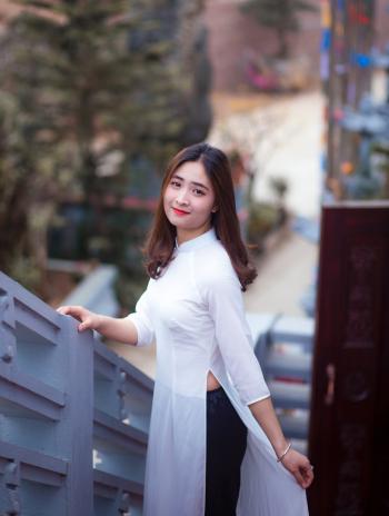 Woman Wearing White Slit Side Dress