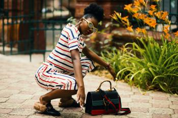 Woman Wearing White Sunglasses and Stripe Shirt Sitting