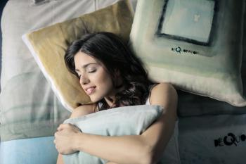 Woman Wearing White Tank-top Sleeping on Gray and White Bedspread