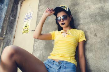 Woman Wearing Yellow Lace-up Neckline T-shirt