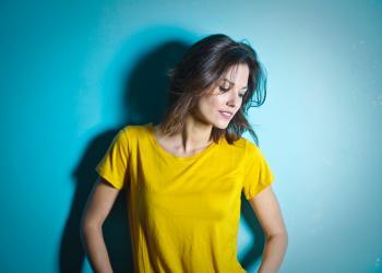 Woman Wearing Yellow Scoop Neck Shirt