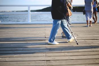 Woman with a crutch