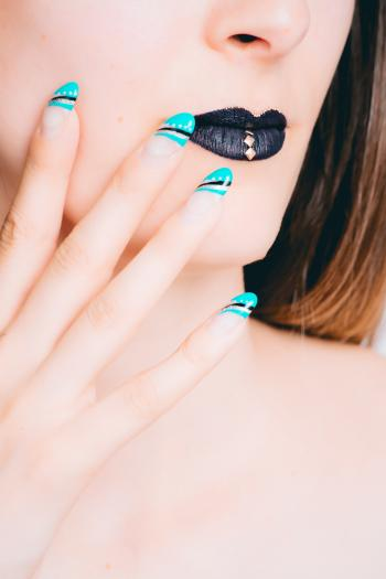 Woman With Black Lipstick and Teal Manicure