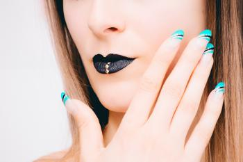 Woman With Black Lipstick and Teal Nail Polish