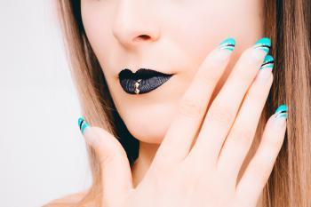 Woman With Black Lipstick and Teal Nail Polish