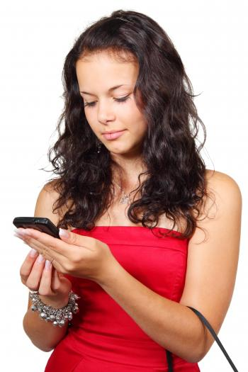 Woman With Handbag on Arm While Using Android Smartphone