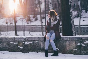 Woman With Umbrella on Snow