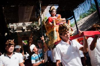 women being carried in temple