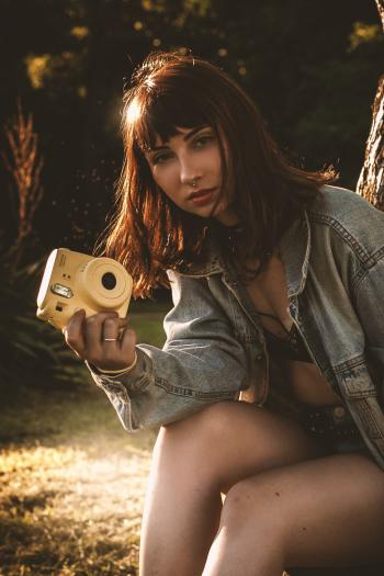 Women Wearing Blue Denim Jacket Holding Yellow Fujifil Instax Mini 8